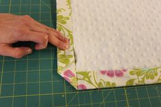 If you can sew a straight line, you are going to love this tip for creating a beautiful, professional looking, baby blanket with mitered cor...