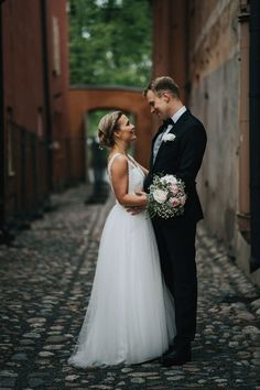 Real wedding in Finland. Dress made by Pukuni (www.pukuni.fi). Wedding dress with lace, tulle and open back. Photography / Niko Sieppi