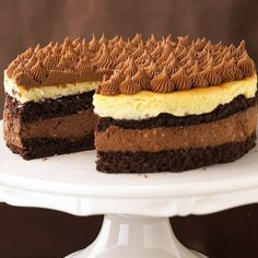 Layers of ganache and creamy cheesecake create an irresistible dessert. More decadent cakes: http://www.bhg.com/christmas/recipes/holiday-cakes/?socsrc=bhgpin022313bittersweettorte=22