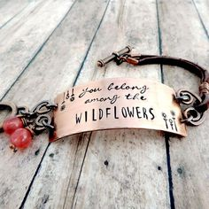 """Handmade copper and leather bracelet stamped with words from Tom Petty song""""you belong among the wildflowers"""" with stamped flowers. Unique boho jewelry for free spirited woman and flower child. Bridal Jewelry, Gold Jewelry, Metal Jewelry, Jewlery, Jewelry Quotes, Jewelry Ideas, Diy Jewelry, Jewelry Design, Jewelry Insurance"""