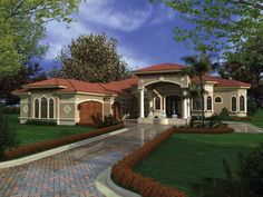 Contemporary open layout gives this Spanish Mediterranean style home a spacious appeal. Spanish Mediterranean House Plan # 61120.