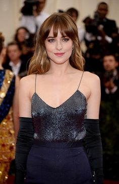 Makeup artist Mary Phillips gave Dakota Johnson a natural, soft look to compliment her bold custom Jason Wu navy micro-beaded camisole with navy silk gauze full skirt. Inspired by Dakota's vibrant blue eyes, Mary gave her a smoky eye in rusts and added a hint of pink to her lips for a youthful touch of color. #LancomeRedCarpet #JasonWuforLancome