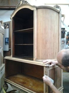 This 1930s China cabinet has been stripped of its original color, hand sanded, and prepped for staining.  #antique #restoration #chinacabinet #woodwork #tradework #oscardecinc