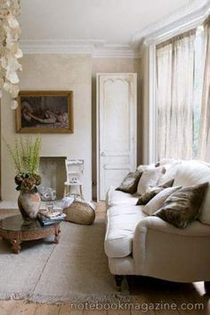 Living room in neutrals with cool wall texture.