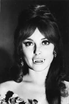 Sharon Tate with vampire fangs, 1967.