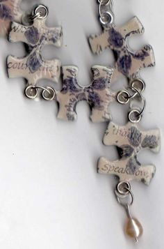 Jigsaw Necklace - or - take puzzle pieces, treat the same, turn into pins for a cork board