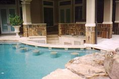 pools with outdoor kitchen | Description: Swim up bar, sunken outdoor kitchen, granite capped bar ...