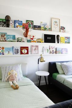 Picture ledges as bookshelves, running the length of a shared bedroom for kids
