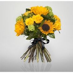 Bursting with colour is the Sunshine Bouquet of bright sunflowers, yellow roses and viburnum