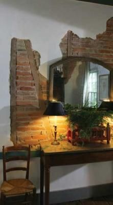 The Slightly Exposed Brick Gives The Wall Such A Warm, Vibrant Feel.