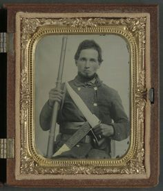 LOC #32623 - Unidentified soldier in Confederate uniform with musket, D guard Bowie knife, and engraved knife sheath.