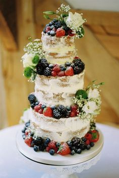 Delicious fruit and flower naked cake / http://www.deerpearlflowers.com/rustic-berry-wedding-cakes/