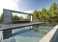 Architect Luciano Kruk built an exposed concrete house set amidst a pine forest on Argentina's Costa Esmeralda. Pool House Designs, Swimming Pool Designs, Swimming Pools, Pine Trees Forest, Beton Design, Cap Ferret, Villa, Forest View, Concrete Houses