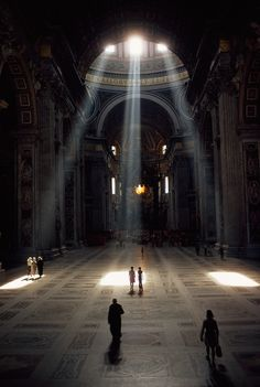 hree shafts of sunlight illuminate the basilica and its mosaic floor in the Vatican, December 1971. Photograph by Albert Moldvay, National Geographic