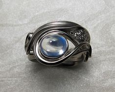 Contemporary, Art Nouveau style engagement ring, with blue moonstone. — Metamorphosis Jewelry
