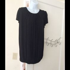 Black shirt Has ruffled detail at the top and zips in the back Forever 21 Tops