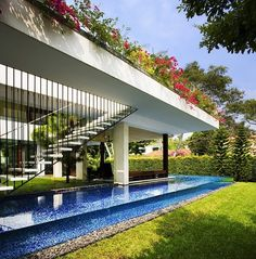Contemporary interpretation of a traditional courtyard house designed by Guz Architects located in Singapore. Tangga House by Guz Architects