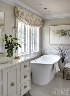 Silk wallcovering and mosaic tiles make the spa-like master bathroom a luxurious retreat.