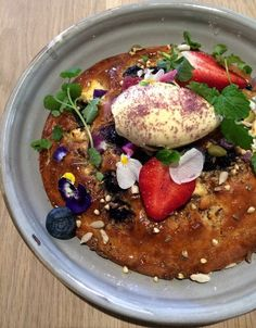 ricotta hotcake, blueberries, edible flowers, double cream, violet sugar, seeds, maple syrup