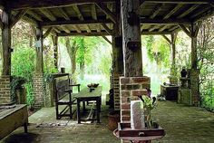 This outdoor gathering space would look spectacular with some globe string lights hanging from the rafters.  Dream.
