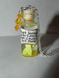 Customizable Awareness Ribbon,Endometriosis Awareness Ribbon in a Bottle Pendant/Keychain (YELLOW). $20.28, via Etsy.