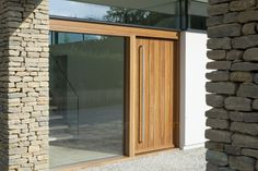 our new porto pivot with a clear glazed sidelite on the Hurst house. For more information, visit urbanfront.co.uk