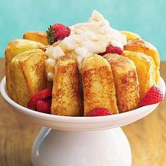 French-Toasted Angel Food Cake Angel food cake is made into light and sweet French toast in this breakfast recipe. Also try it for dessert! Angel Cake, Angel Food Cake, Strawberry Syrup, Sponge Cake, Griddles, Creme Fraiche, Eye, Melted Butter, Whipped Cream