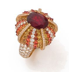 """LORENZ BAUMER RING """"OURSIN A SECRET"""" It is adorned with a framed cushion almandine garnet yellow sapphires, brilliant-cut diamonds and mandarin garnets set some in Perpignan. The base of the ring discovers a secret cover. Enhanced mount 18K yellow gold with brilliant cut diamonds."""