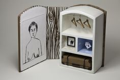 "Artists' book by Naz Rahbar. ""non being"", dry-point print, miniature objects, screen printed wood pattern. Jan 2013"