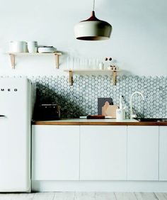 While you are no doubt aware that subway tile backsplashes in the kitchen are currently freakishly popular, we're here to show you something a little different. These tile backsplashes aren't modest or understated — they're anything but. If you want to add some showstopping color to your kitchen, look no further than these inspiration photos.