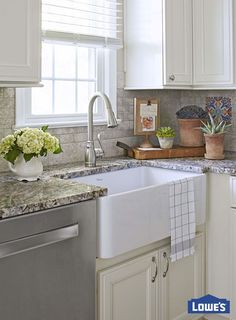 Dish duty becomes a little sweeter with a few stylish and practical kitchen updates. Create a convenient cleanup zone by pairing a charming farmhouse sink and a pull-down faucet. Elegant granite countertops complete this designer look.