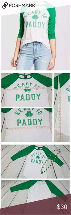 ☘Ready to Paddy☘ Graphic Tee NWT Baseball Top XS Modern Lux raglan style white & green graphic tee. ☘Ready to Paddy☘ in green lettering with green clover and green raglan sleeves against the white body. Style # JT18778. Sporty, baseball type t-shirt with scoop neckline and 3/4 length sleeves. Women's size x-small. Approximate flat lay measurements shown in pic 4. Material: 65% polyester/35% rayon. Machine wash.   Perfect for St. Patty's Day!  New with tags!* *small portion of tag remains due…