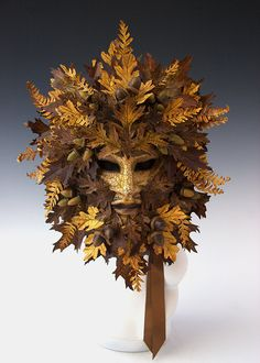 This is a very large mask, 15 x 20. All of the oak leaves and ferns are hand drawn, cut and painted. Ferns have a bit of floral wire on the back