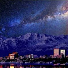Twilight after sunset in downtown Anchorage, Alaska, with the view of Chugach mountains in the background Alaska Winter, Alaska The Last Frontier, North To Alaska, Train Tour, Alaska Travel, Alaska Trip, Anchorage Alaska, Home Of The Brave, Land Of The Free