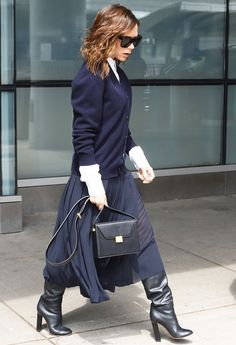 Victoria Beckham was spotted at the airport wearing stylish shoes that aren't exactly TSA-friendly—see them here.