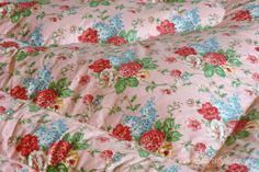 Glorious floral eiderdown (feather quilt)i had one of these on my bed growing up.....wish I still had it.....warm.