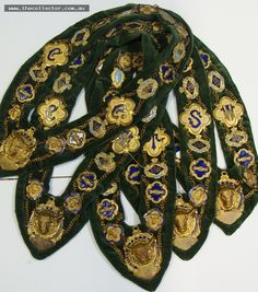 Lot 341 - Approx 5  Royal Anterdiluvian Order of Buffaloes collars - all heavily decorated with enameled badges to green velvet backing - all from South Yarra l