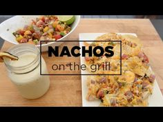 Surprise your friends at your next barbecue with this easy & delicious smoked Nachos recipe.  Ingredients: Tomatoes, Corn on the cob, Red onion, Cilantro, Avocado, Lime, Cheese, Tortilla chips, Oil, Smoked sea salt, Fresh ground pepper & Hot Sauce of your choice