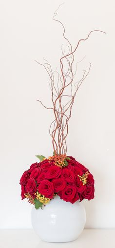 Domed red roses and twisted willow with geiger berries detail. Corporate arrangement by Okishima & Simmonds Limited London www.okishimasimmonds.com