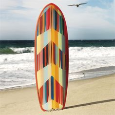 eco surfer. Graphic board rides a wave of sustainability, handcrafted of recyclable EPS foam and USDA-certified bio epoxy. Inventive, eco-minded board makers Todd Patterson and Ryan Harris shaped an ocean-ready canvas for a bold design by Chicago-based artist Brett Whitacre. Rendered with a reverse glass-painting technique, the design reflects the colors of sea life as seen from above.