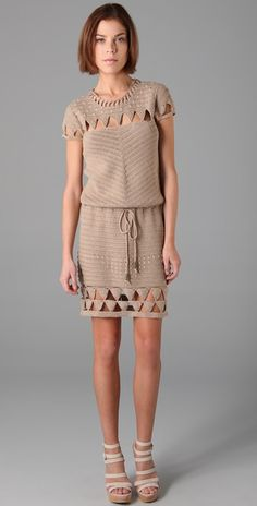 """Mike Gonzalez Crochet Cap Sleeve Dress This crocheted dress features triangle cutouts at the crew neck, yoke, bottom hem, and cap sleeves. Metal-beaded drawstring at waist. * 33"""" long, measured from shoulder. * Fabrication: Crochet. * 100% cotton."""