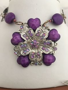 Now available on our store: Silver & Purple H... Check it out here! http://www.thebrasscaliper.com/products/silver-purple-heart-steampunk-repurposed-gramma-pin-necklace-earrings-set?utm_campaign=social_autopilot&utm_source=pin&utm_medium=pin