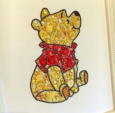 Winnie the Pooh decoration. Button Swarovski crystal framed art. Button art. Button Frame. Disney. Personalised Gift. Winnie the Pooh is created using high quality buttons, rhinestones, and genuine Swarovski crystals. Each piece is made with love and to a high standard. It comes