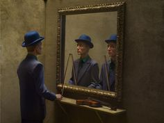 Eugenio Recuenco,artist-  I'm thinking The Riddlers brother..The Punster. Hey! I might have somethin!