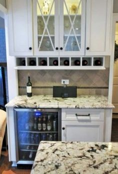 """Closet wine bar w/beverage fridge and 1 cabinet. I plan to do this but with 12"""" 3 drawer base cabinet. Like the glass doors & wine rack above. I'm adding cup rack as well."""