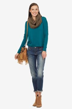 This sweater features a boatneck and a high low hemline.