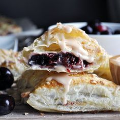 Cherry turnovers with a sweet dark cherry & cream cheese filling, wrapped in puff pastry and drizzled with almond vanilla glaze.