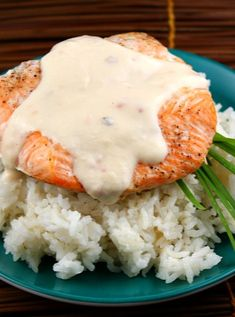 Baked Salmon with Creamy Coconut- Ginger Sauce (one of my favorite dinner recipes EVER.  The sauce is SO good!!) - RecipeGirl.com #food #recipes