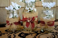 Mason jars wrapped in burlap and red fabric shabby chic country decor indoors or outdoors. $25.00, via Etsy.