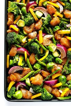 """This delicious Sheet Pan Chicken and Veggies """"Stir Fry"""" dinner recipe is quick and easy to prepare, and made with a delicious sesame-soy dressing that everyone will love. Plus, it's easy to make-ahead and refrigerate if you'd like to do some meal planning for the week! 